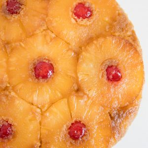 A close up of a pineapple upside down cake