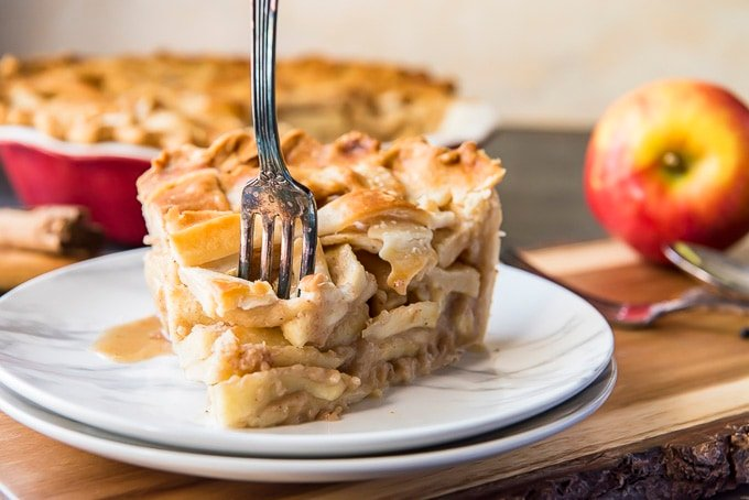 Fork sinking into a slice of Classic Apple Pie