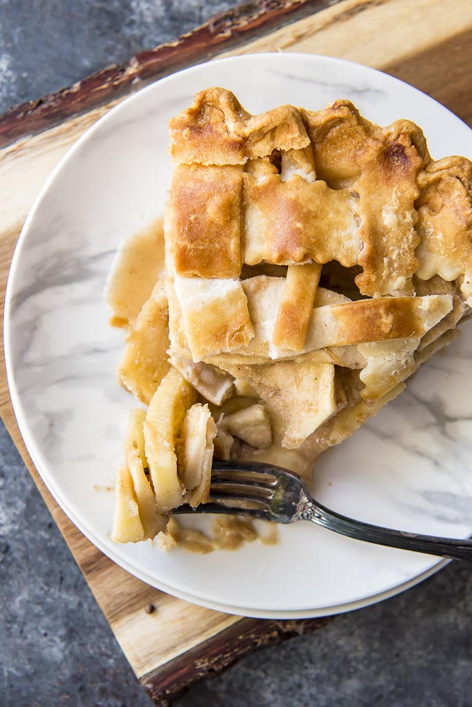 looking down at a Classic Apple Pie slice with a fork