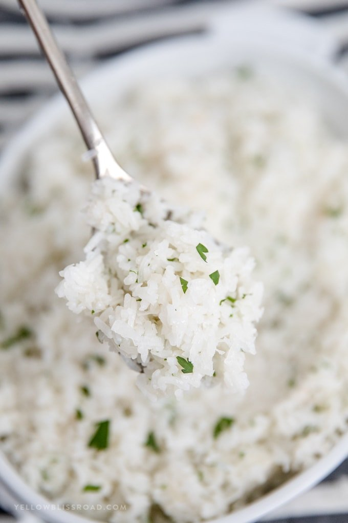 Coconut Rice recipe - spoonful of rice on a silver spoon.