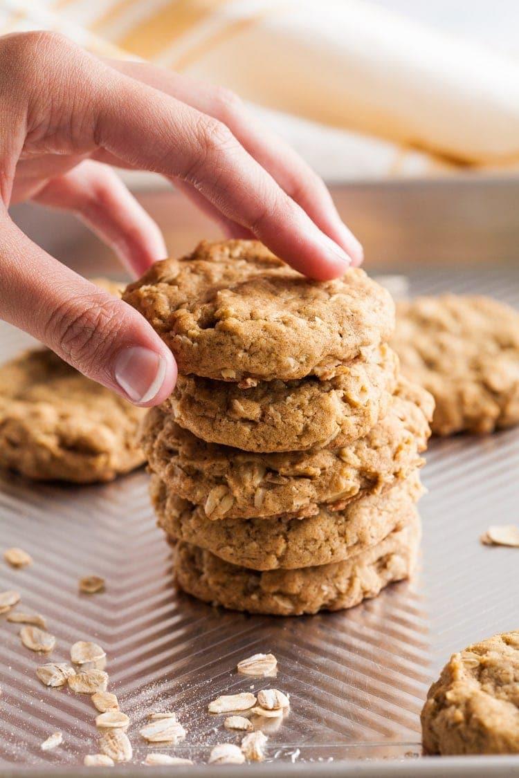 hand reaching for an oatmeal pumpkin cookie