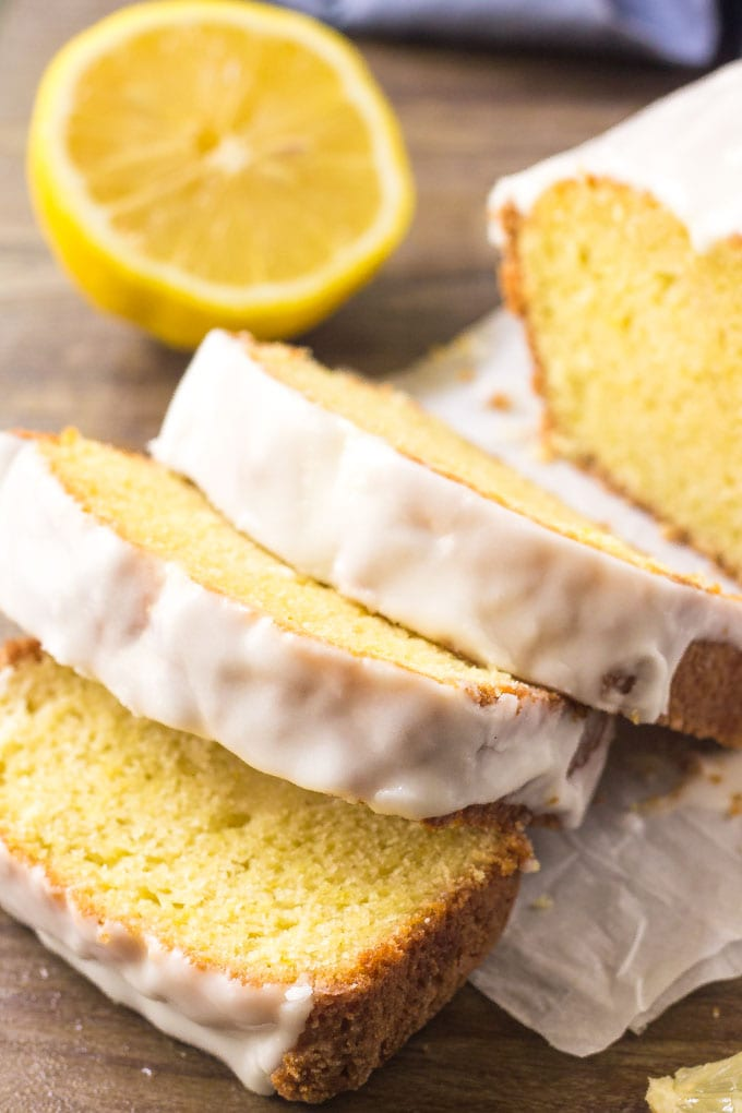 A freshly cut Starbucks lemon loaf with sweet lemon icing.