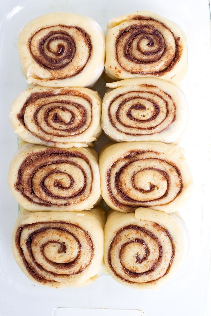 homemade cinnamon rolls in a pan ready to be baked