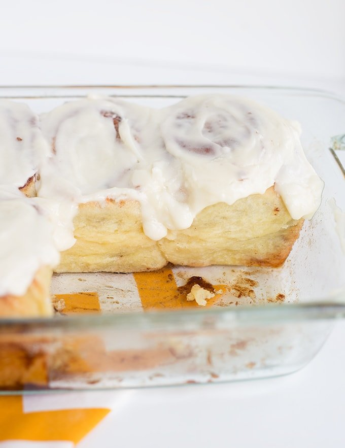 pan of homemade cinnamon rolls with a few taken out