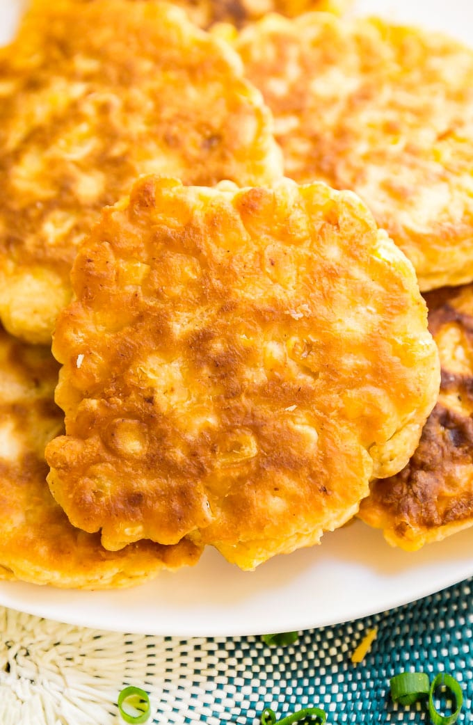 Loaded Corn Fritters are a light and fluffy corn cake topped with all the fixings to make this the a killer game day snack!