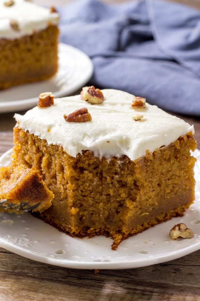 A large slice of sweet potato cake with a bite eaten out of it.