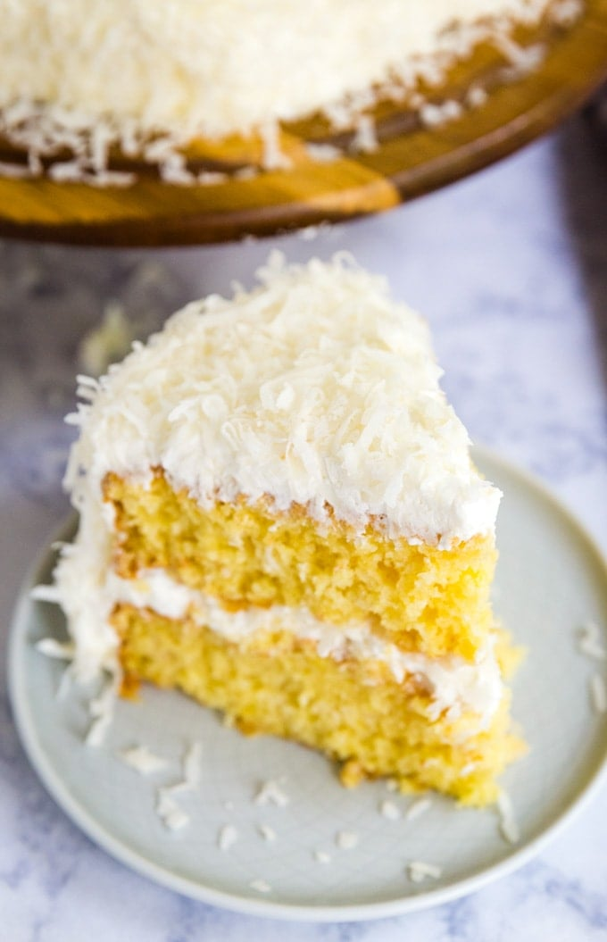 a slice of coconut cake on a dessert plate