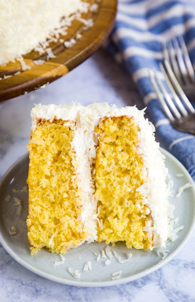 slice of coconut cake on its side on a plate