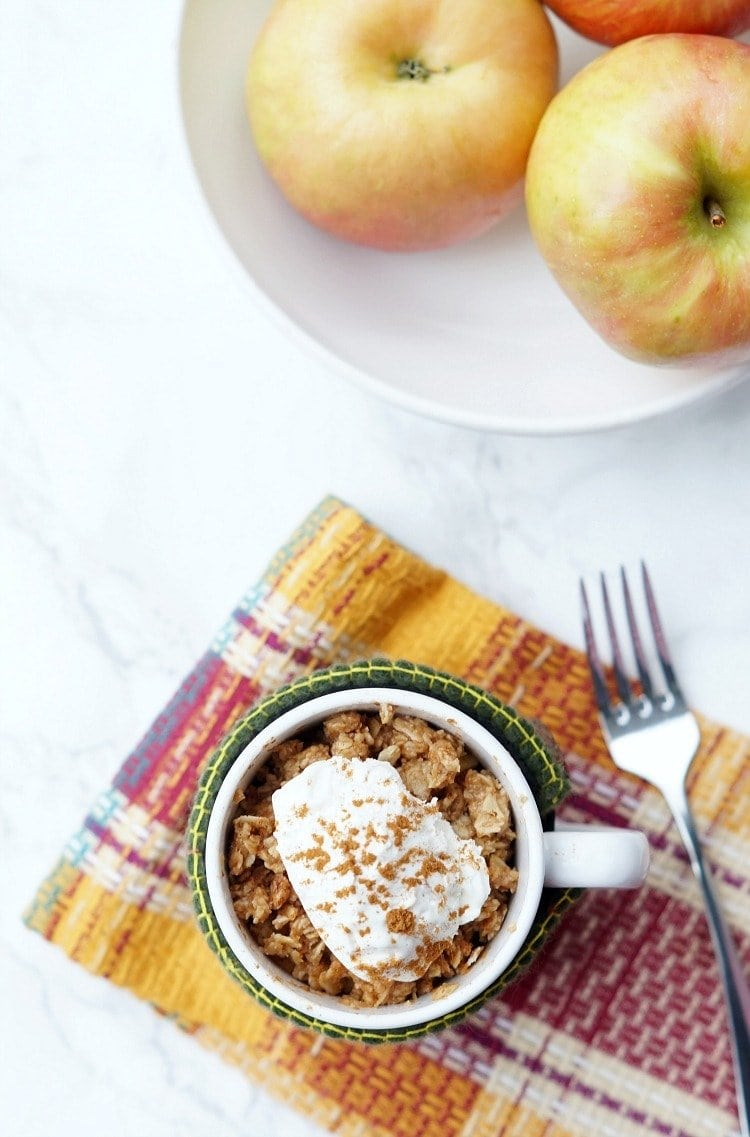 looking down at a microave apple crisp in a mug after cooking