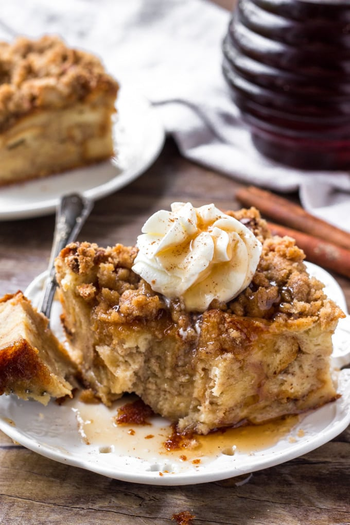 A big slice of cinnamon baked french toast with a bit taken out of it.