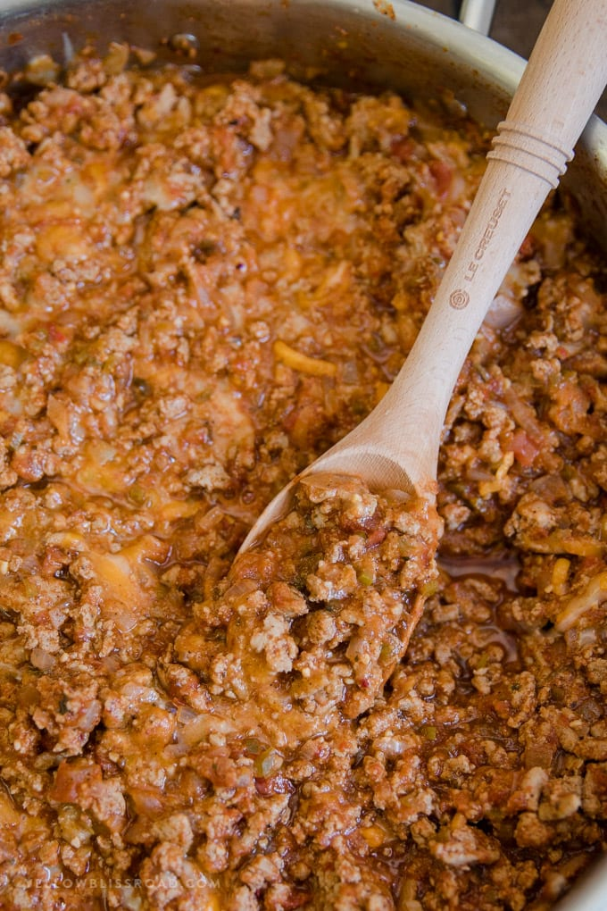 Ground Turkey Taco meat in a pot with a wooden spoon.