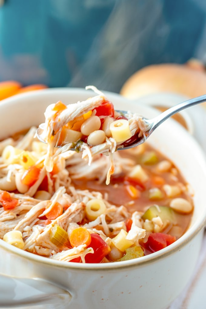 30 Minute Chicken Minestrone Soup in a bowl with a spoon.