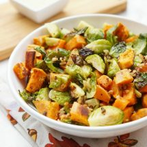 This delicious combination of roasted Brussels sprouts, sweet potatoes, and grains topped with a creamy apple vinaigrette is the perfect Thanksgiving Salad