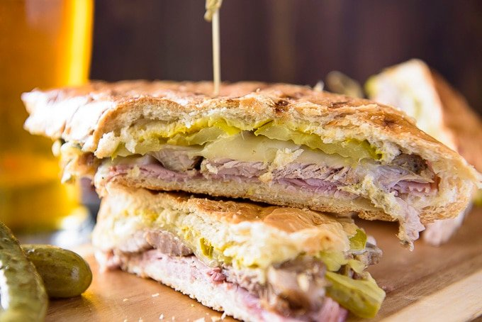 Two halves of a cuban sandwich stacked.