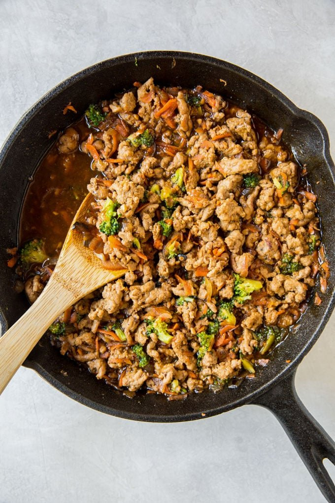 Cooked ground turkey recipe in a skillet with vegetables and teriyaki sauce