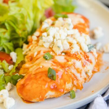 A plate of Buffalo chicken with salad