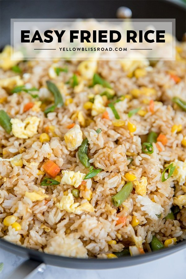 Easy Egg Fried Rice in a skillet with the title written on the photo.