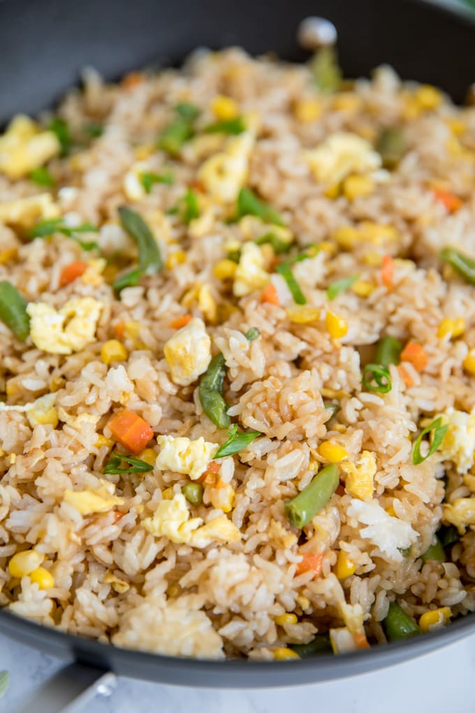 Easy Fried Rice with Egg and vegetables in a large skillet.