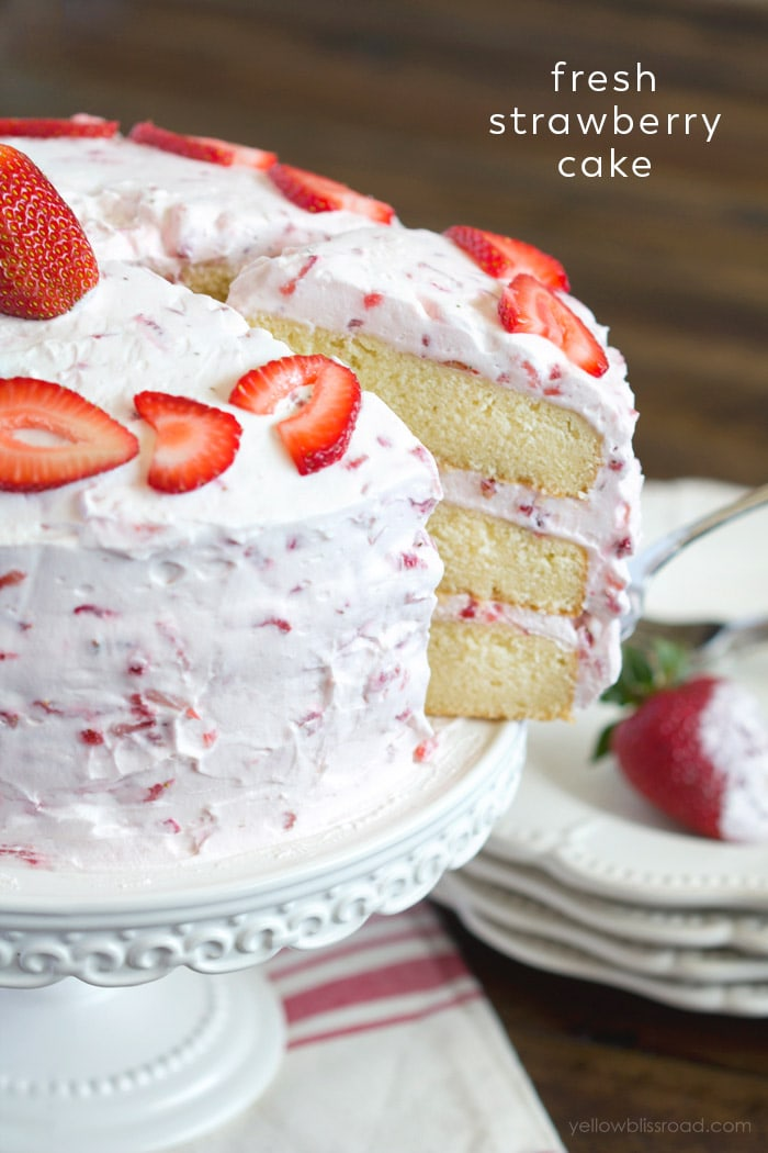 Strawberry cake - A three layered vanilla cake with strawberry whipped cream frosting