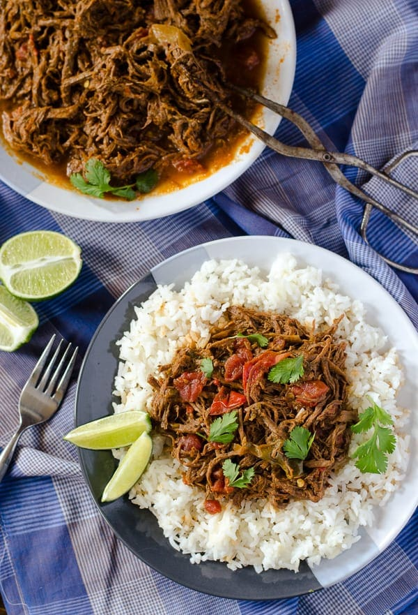 Ropa Vieja on a bed of white rice.