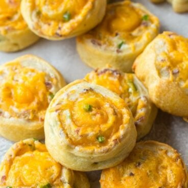 Plate filled with bacon cheddar jalapeno pinwheels