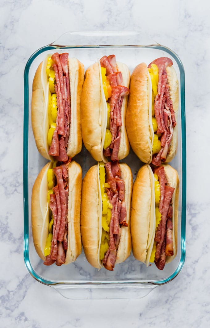 6 sub sandwiches in a baking pan.