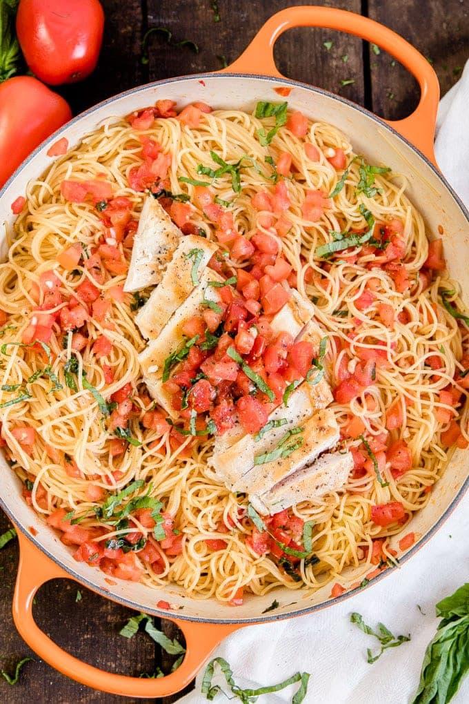 An overhead shot of a pan of Bruschetta Chicken Pasta.