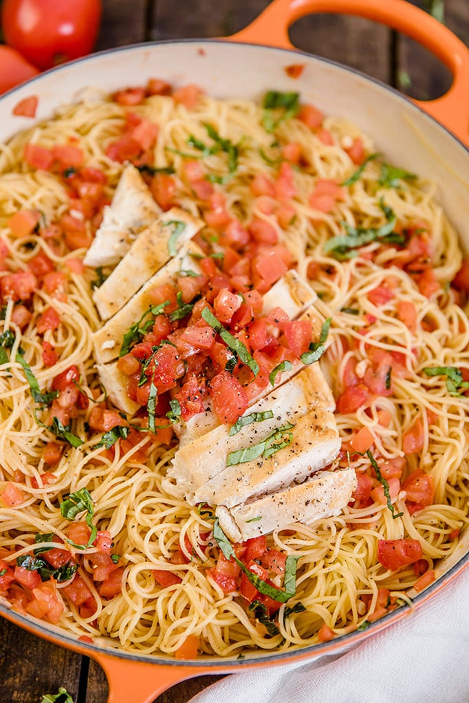 A pan of Bruschetta pasta with chicken and tomatoes.