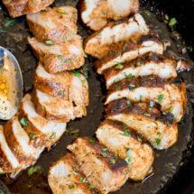 Pan with sliced Cajun pork tenderloin