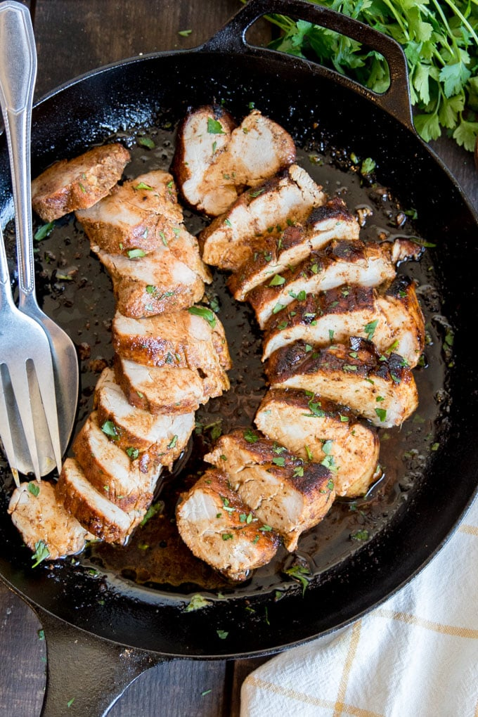 An overhead shot of Cajun Pork Tenderloin in a cast iron skillet.