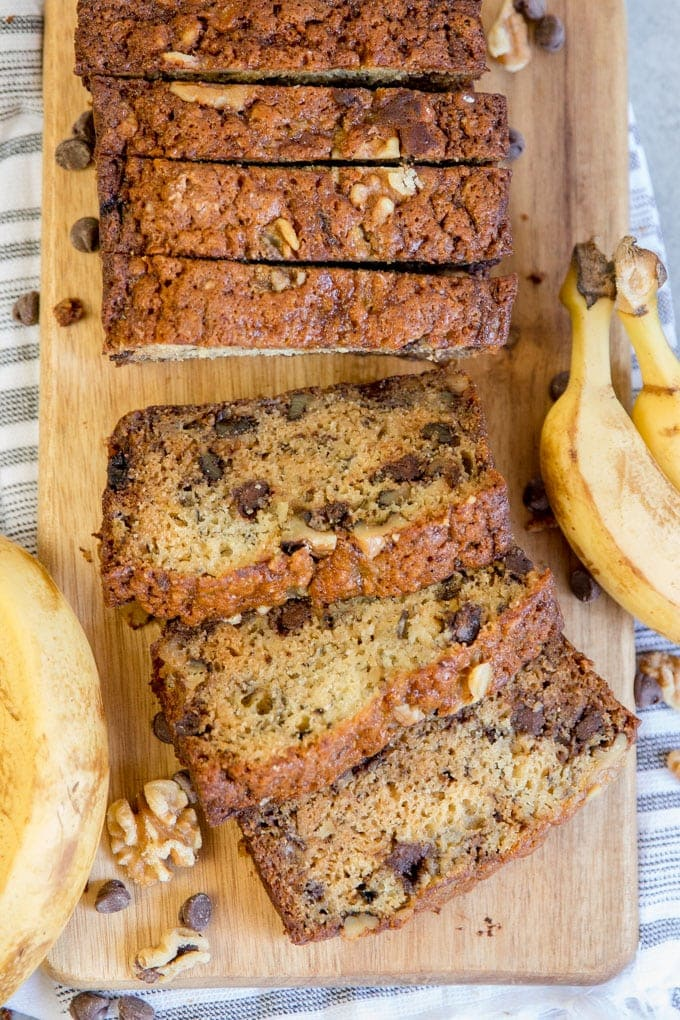 A loaf of chunky monkey banana bread sliced.