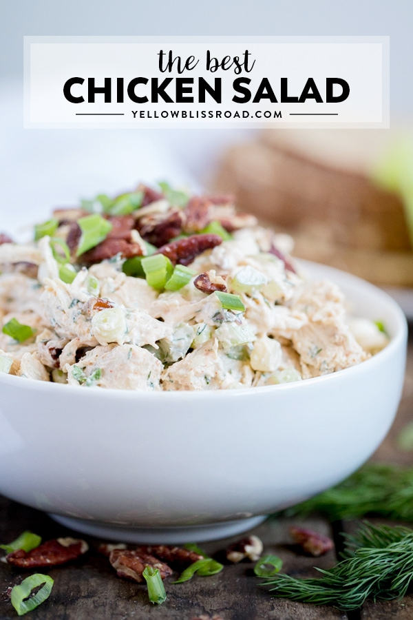 Chicken Salad in a white bowl topped with pecans