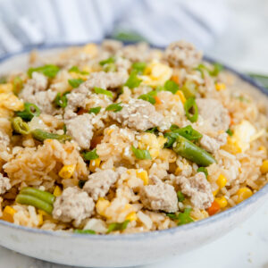 A dish is filled with Pork Fried Rice