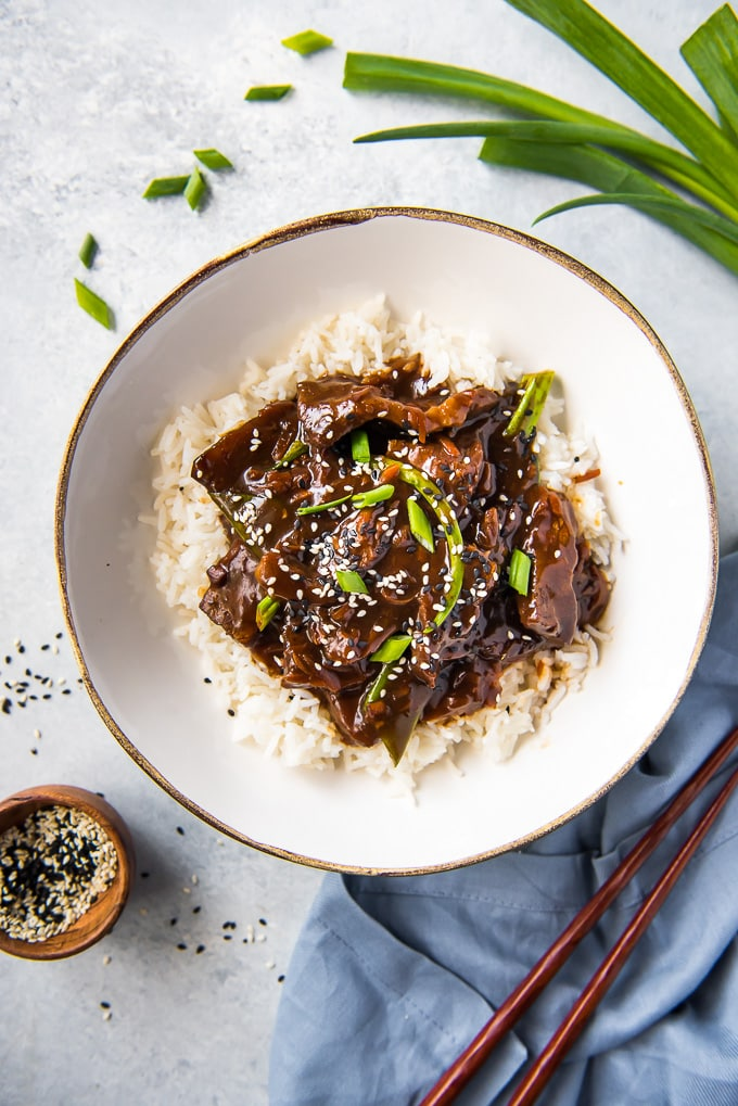 Slow Cooker Mongolian Beef in a bowl on a bed of rice