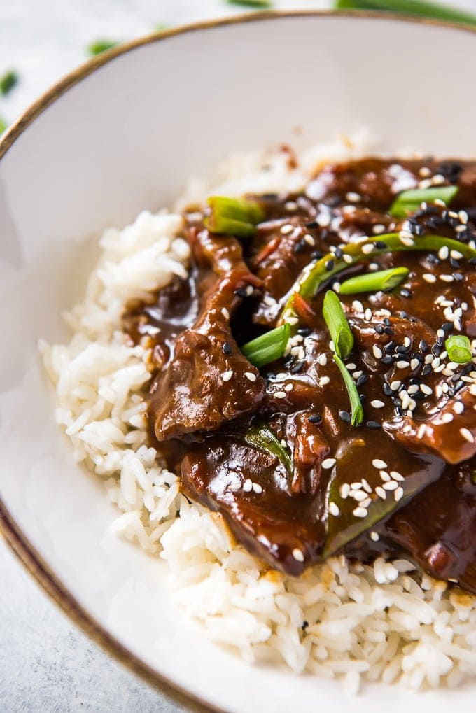 Close up of Slow Cooker Mongolian Beef on a bed of rice