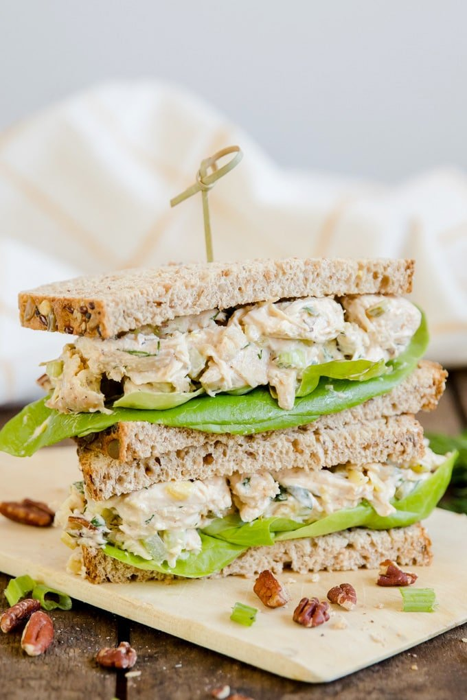 Two halves of a chicken salad sandwich stacked