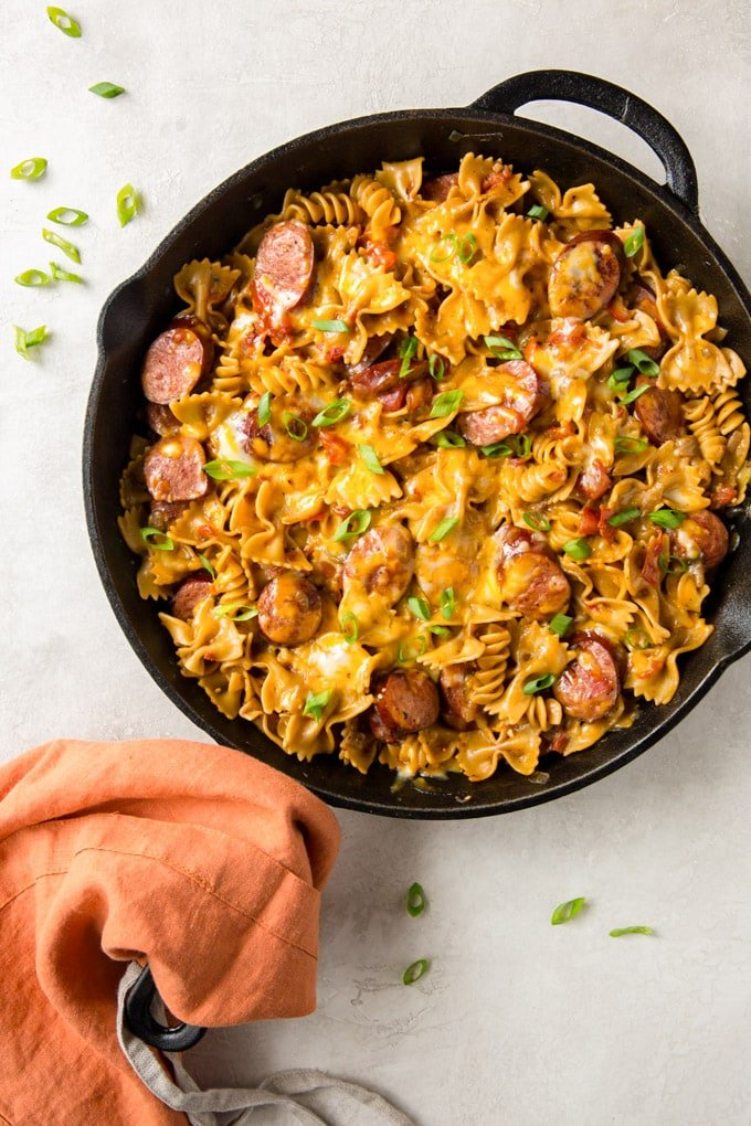 Smoke Sausage Pasta in a large skillet with a cheesy tomato sauce