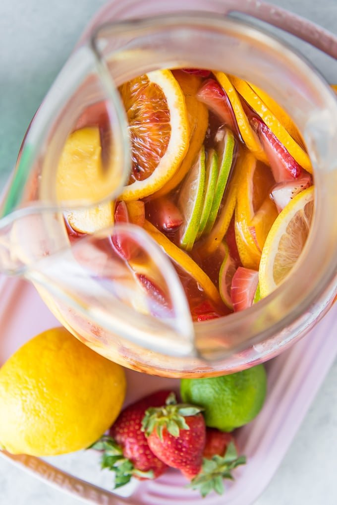 An overhead shot of a pitcher of White Sangria