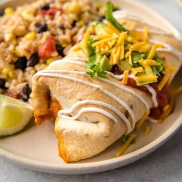 A plate of Chimichangas and rice