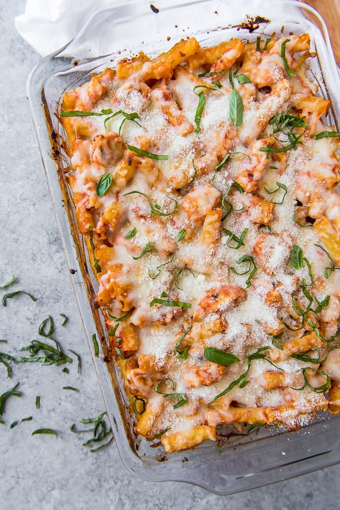 An overhead shot of a chicken parmesan baked ziti casserole