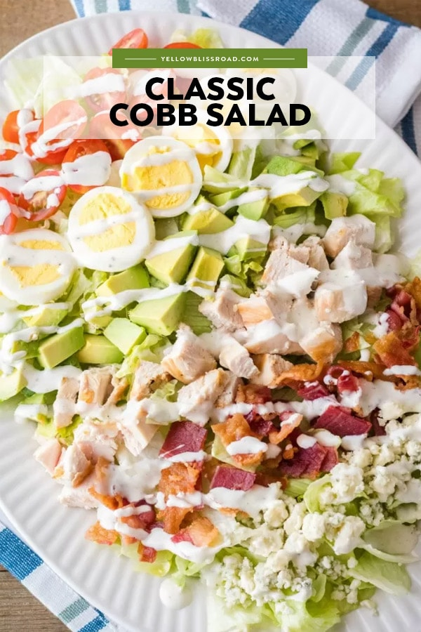 A plate of Cobb salad with dressing