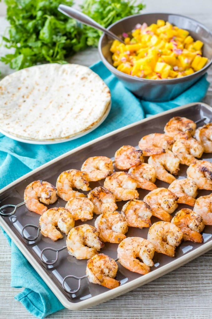 grilled shrimp on skewers with grilled tortillas and mango salsa