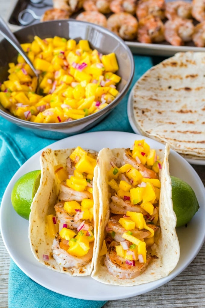 grilled shrimp tacos topped with mango salsa