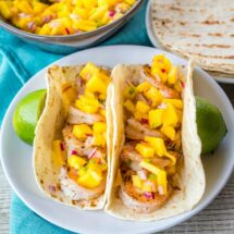 Grilled Shrimp Tacos are a 15-minute meal that's perfect for your next cookout! Colorful and delicious, they'll fly off the plate!