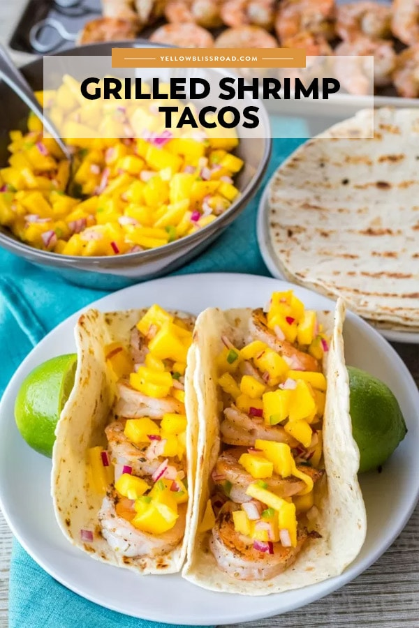 Grilled Shrimp Tacos on a plate. A pinnable image with title text