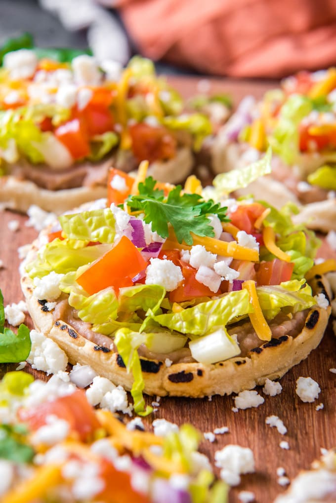 A close up picture of a mexican sope with toppings
