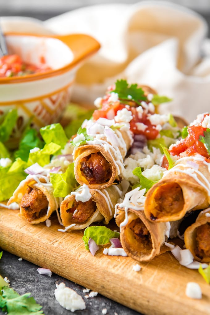 A stack of crispy fried taquitos
