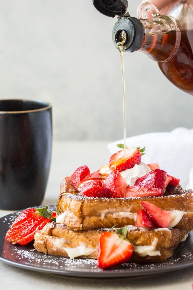 Syrup being poured over cream cheese stuffed french toast
