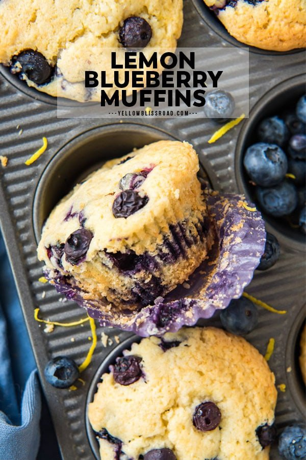 An unwrapped lemon blueberry muffin sits sideways in a muffin pan.