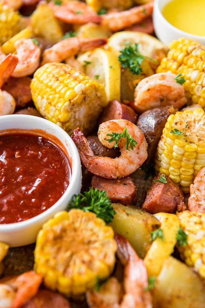 Sheet pan shrimp boil - a sheet pan with shrimp, corn, sausage and potatoes